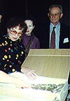 Lorna Scherzer examining ritual objects during the Prague Symposium, 1995